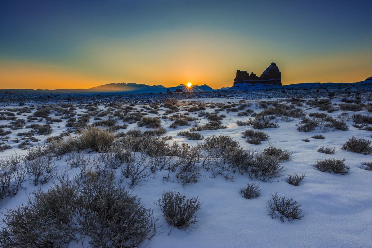 Sunrise over LaSal Mountains near Courthouse Towers, Arches National Park, Utah. Visiting in the dead of winter made this a quiet...
