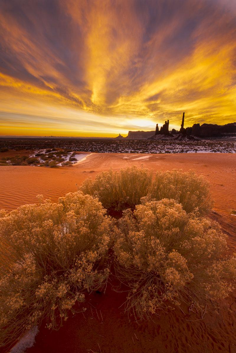 Winter sunrise over Totem formation in Monument Valley Navajo Tribal Park, Arizona.