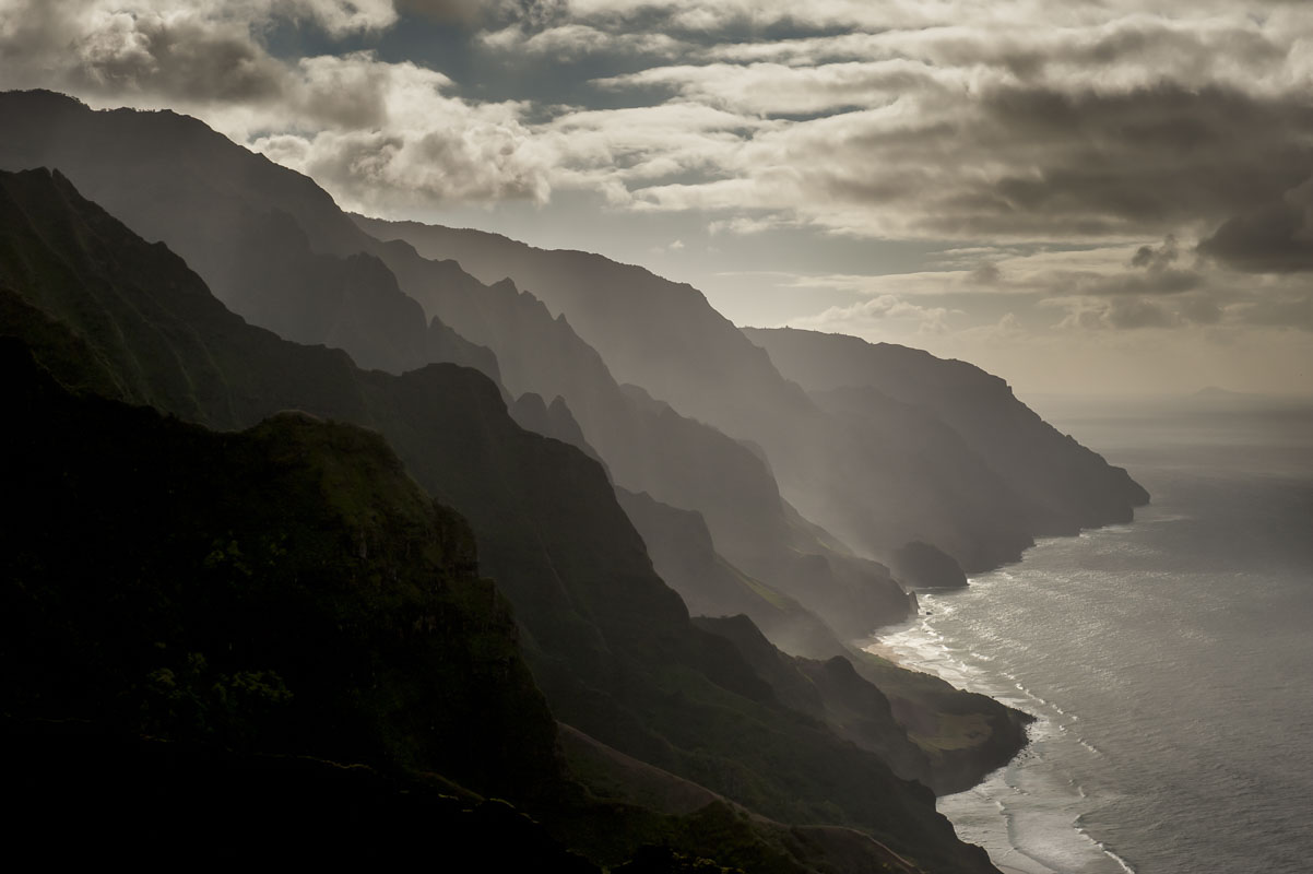 Late afternoon view of the Na Pali Coast on Kauai, Hawaii. With the angle of the sun, the scene photographed as a monochoromatic...