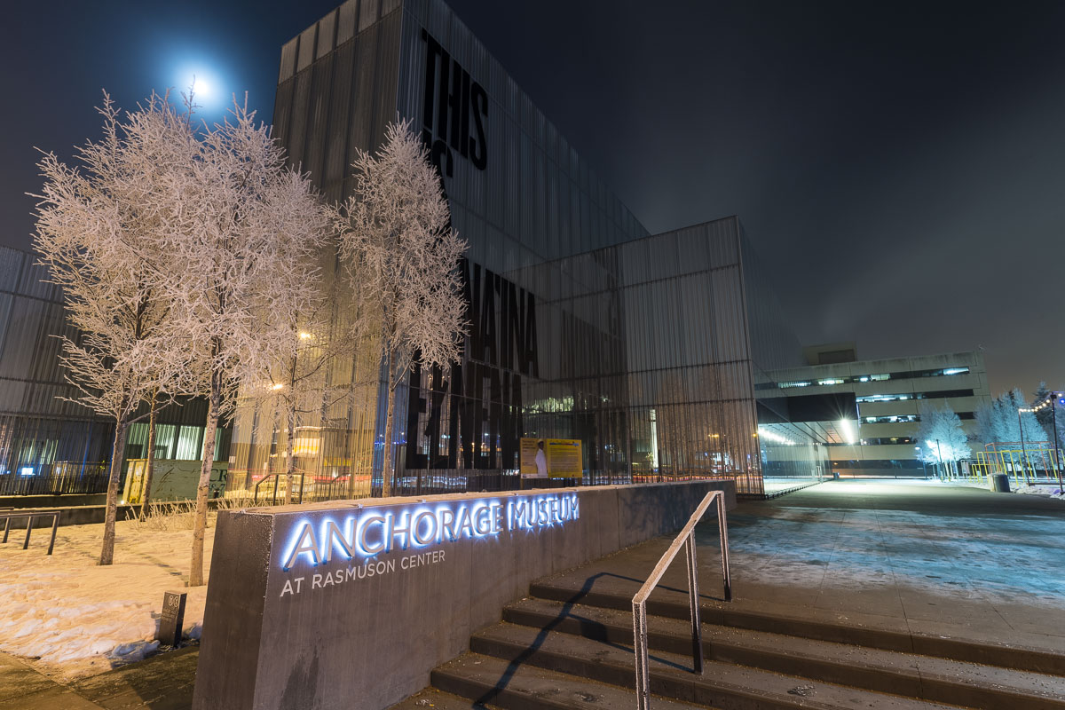 The moon shines through ice fog over the Anchorage Museum at Rasmuson Center on a frosty night.