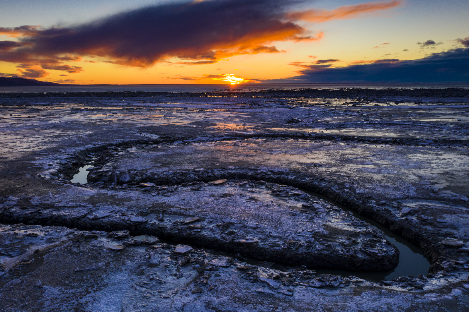 The Rabbit Creek outflow cuts its way through the mudflats of the Anchorage Coastal Wildlife Refuge at low tide.
