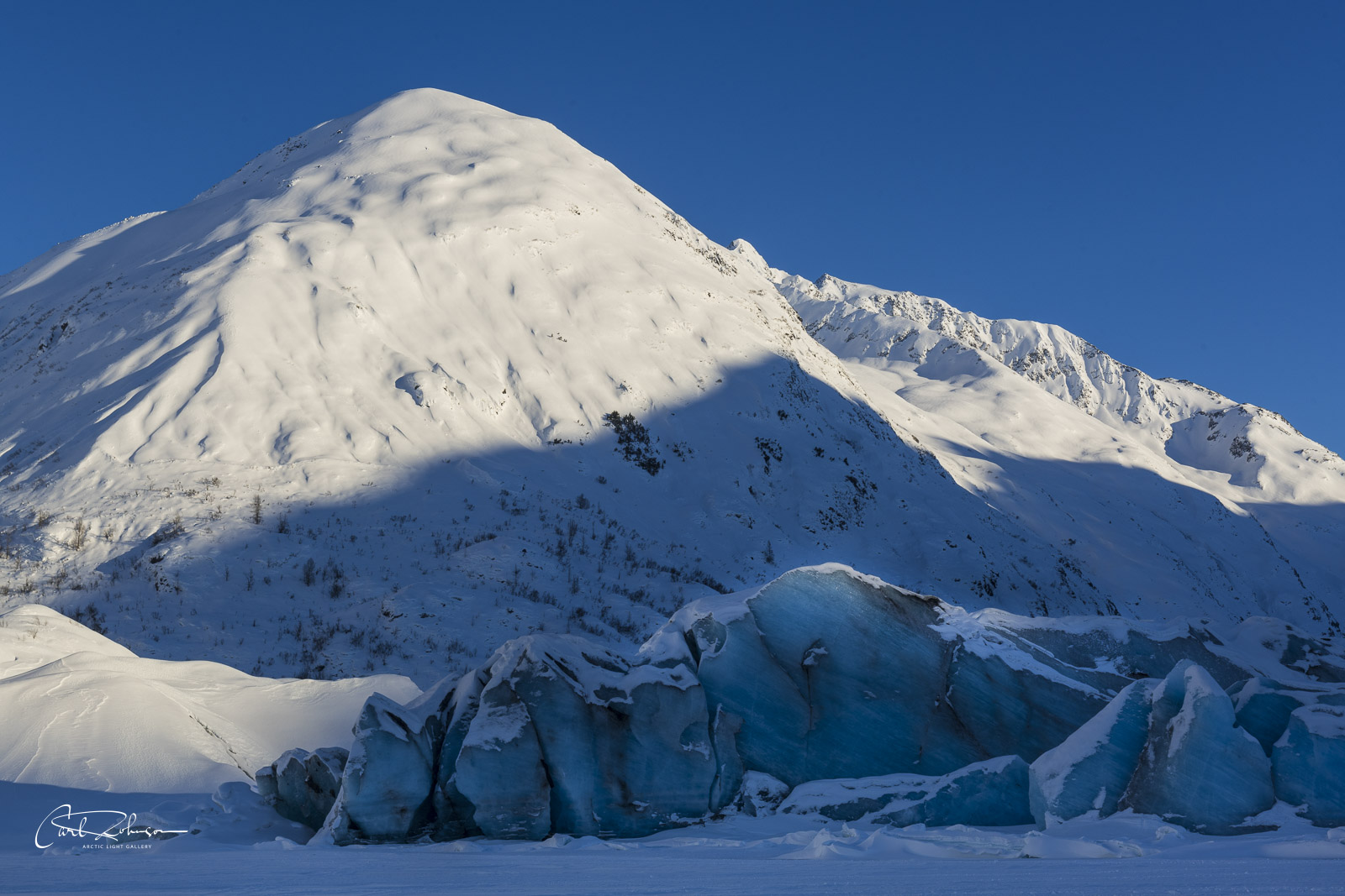 The late afternoon light lightly brushes the edge of the toe of Spencer Glacier.