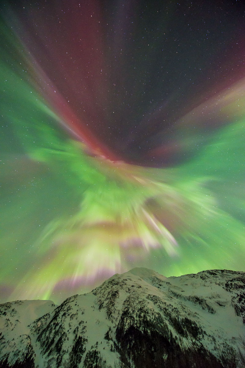 During a powerful storm on St. Patrick's Day, 2013, the aurora displayed at various times all the colors available. Here, a vibrant...