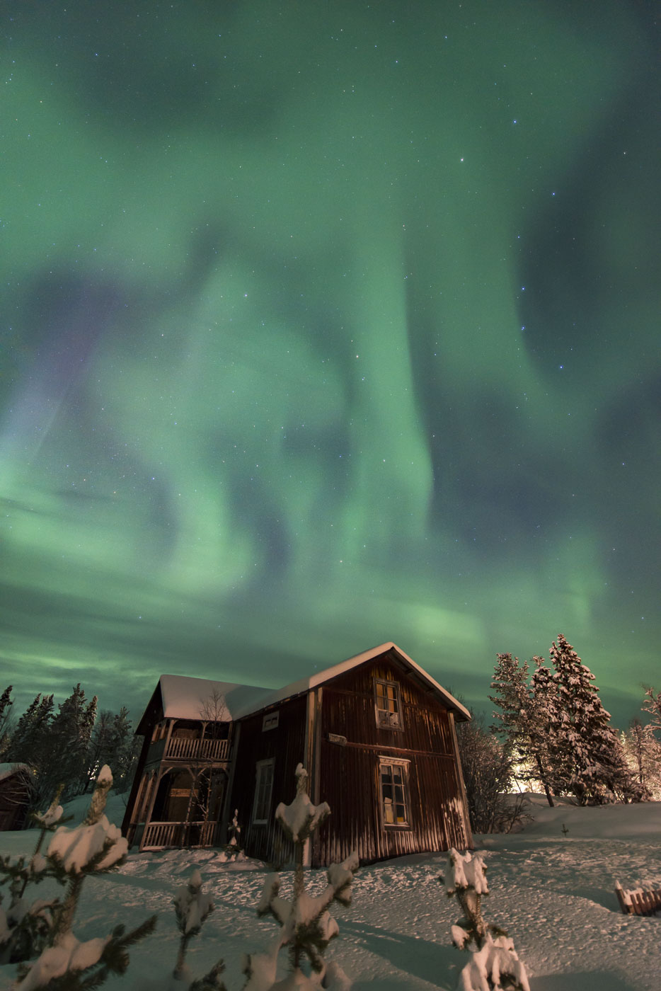 Aurroa borealis over old cabin at Slussfors, Sweden.