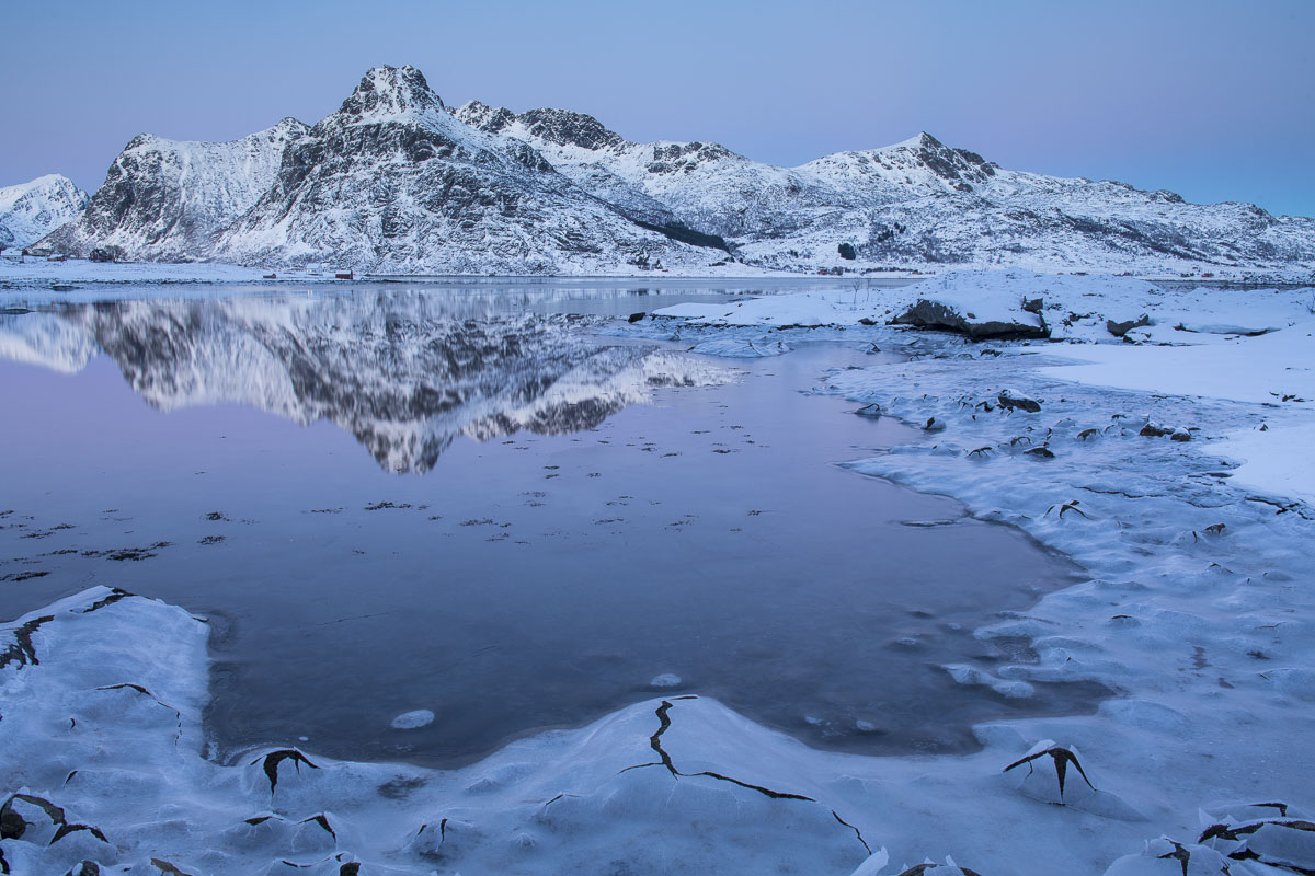 The Lofoten Islands in Norway offer unending views of islands, channels and fjords. Here, subtle winter pastels of blues and...