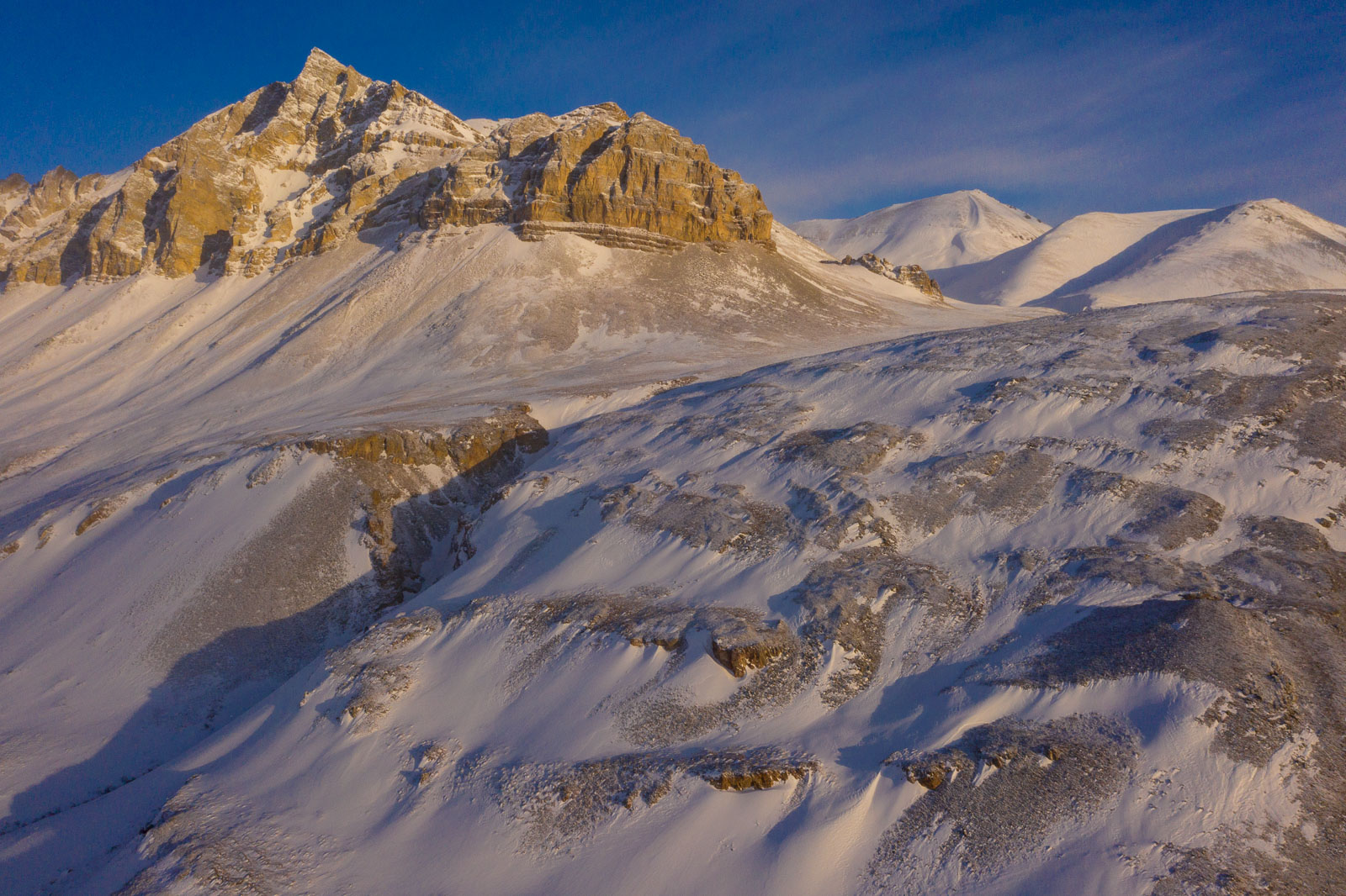 Snow drifts across the lower part of an unnamed mountain in the northern Brooks Range.