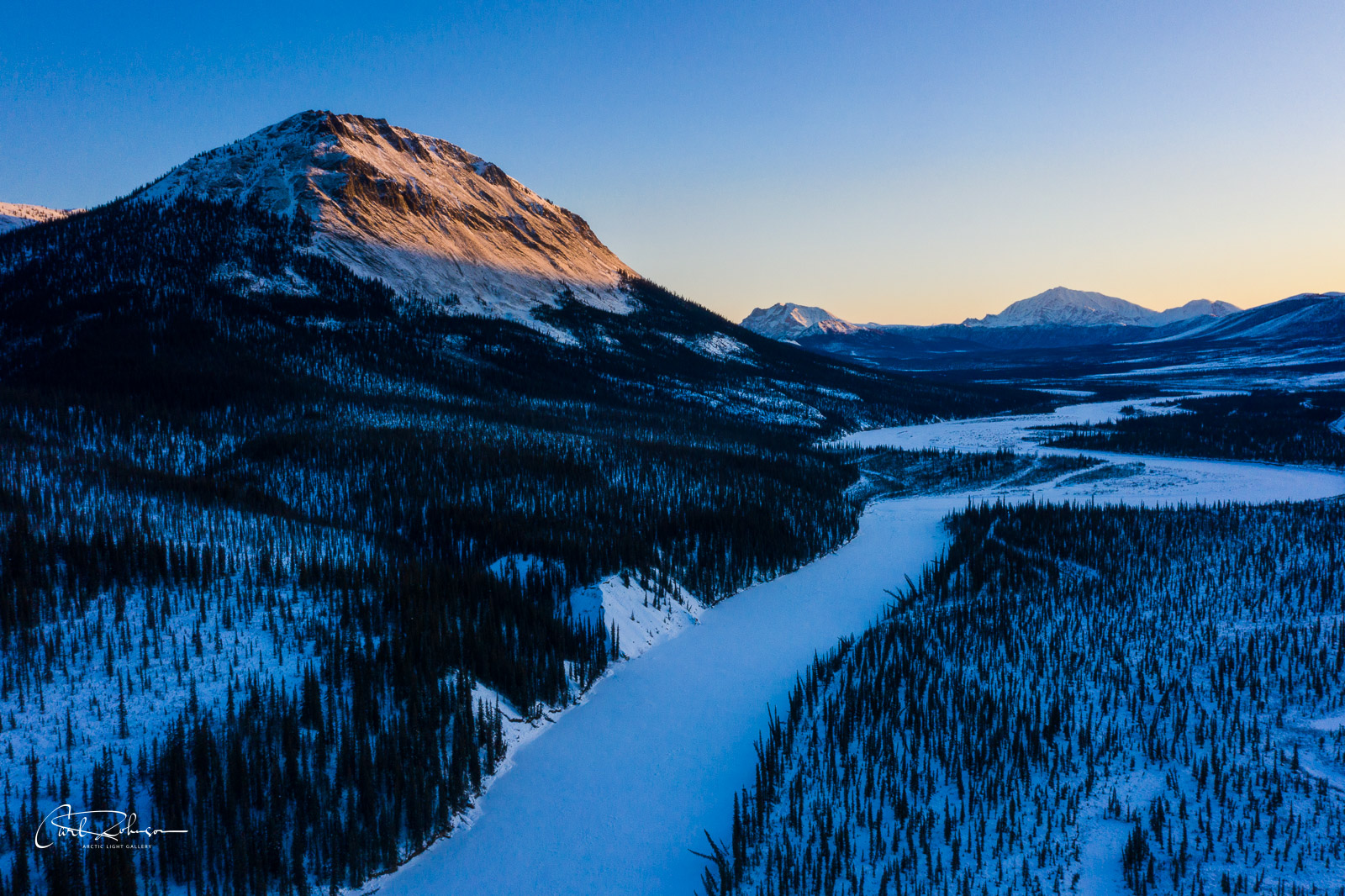 An unnamed mountain catches the first light of the day above the Middle Fork of the Koyukuk River in the Brooks Range of Alaska...