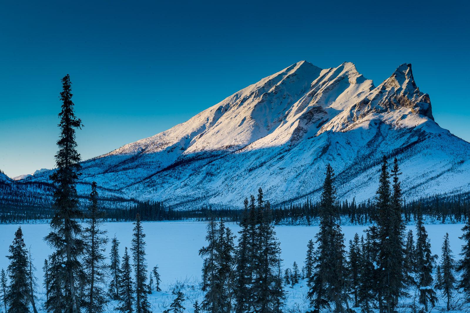 Morning light shines on the north face of Sukakpak Mountain in the Brooks Range, Alaska.