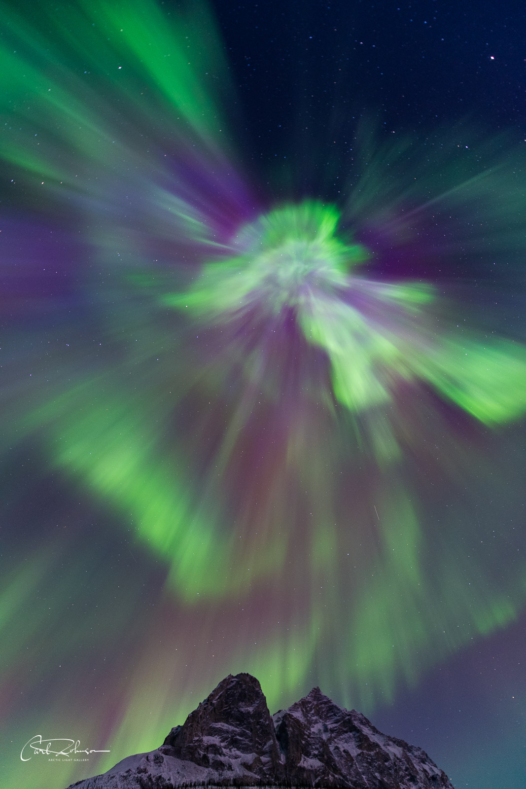 A corona display from a Kp6 aurora soars over Mt. Sukakpak, Brooks Range, Alaska.