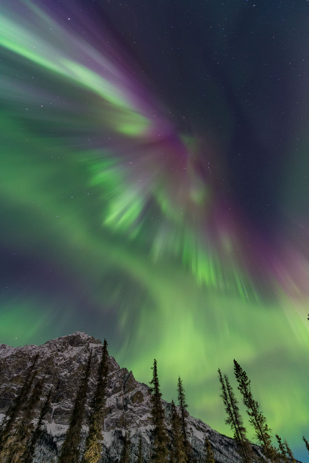 A large display of the aurora borealis fans over Mt. Dillon in the Brooks Range, Alaska.