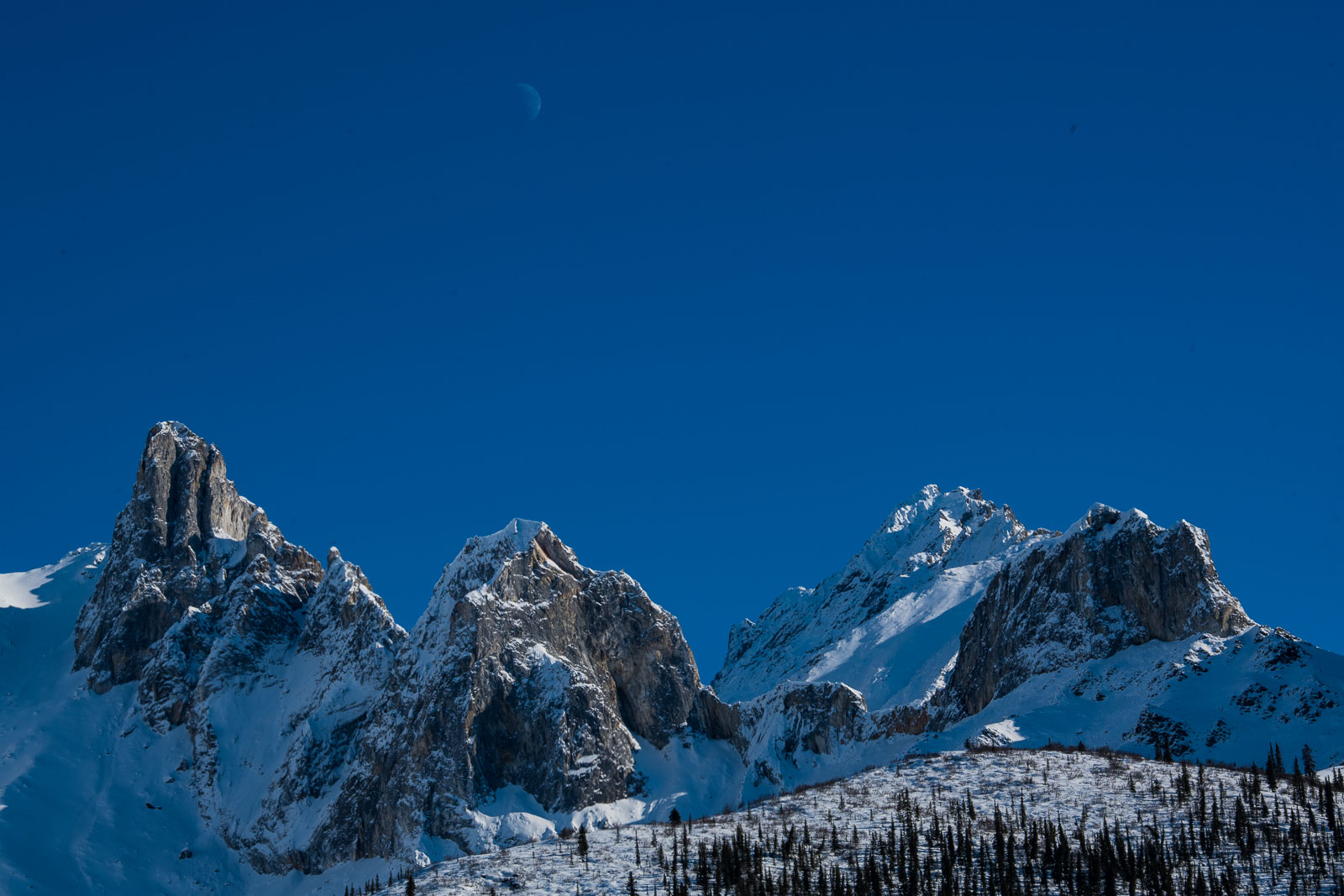 The moon floats over the ridge of an unnamed mountain in the Brooks Range of Alaska.