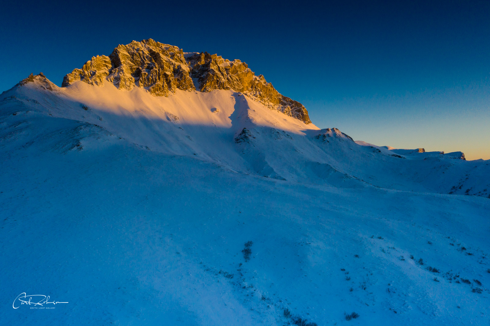 The last light of the day shines a spotlight on a mountain in the Brooks Range of Alaska.