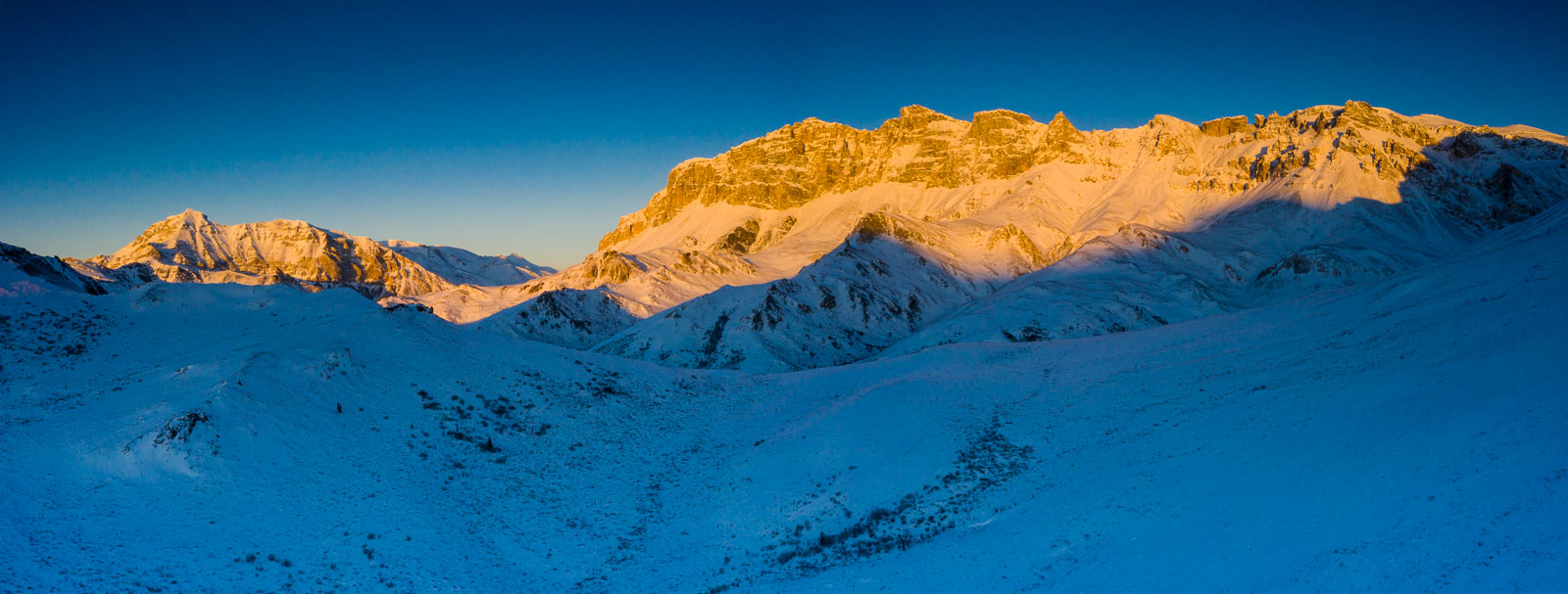 Evening light and shadow create lines upon the high alpine landscape in the Brooks Range of Alaska.