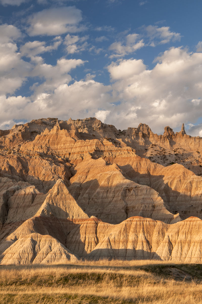 Evening light on formations near the Castle Trail in the Cedar Pass area , Badlands National Park, South Dakota.