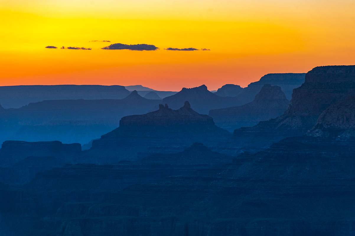 The last colors of sunset make the sky glow over the South Rim of the Grand Canyon. Haze in the air is pollution from Las Vegas...