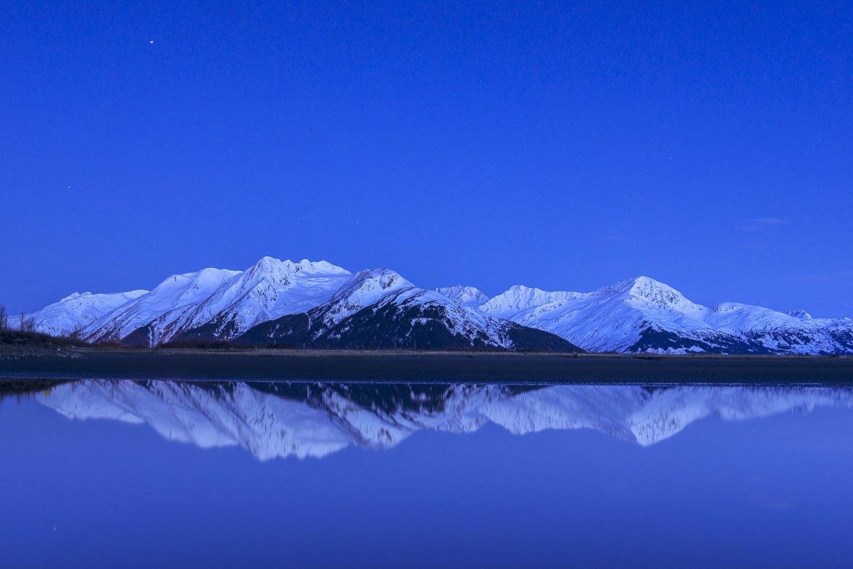 Blue hour light washes over the Chugach Mountains at Twentymile River along the Turnagain Arm.