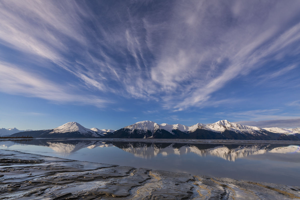 Patterns in the sky and mudflats are accented in early morning light along the Turnagain Arm.