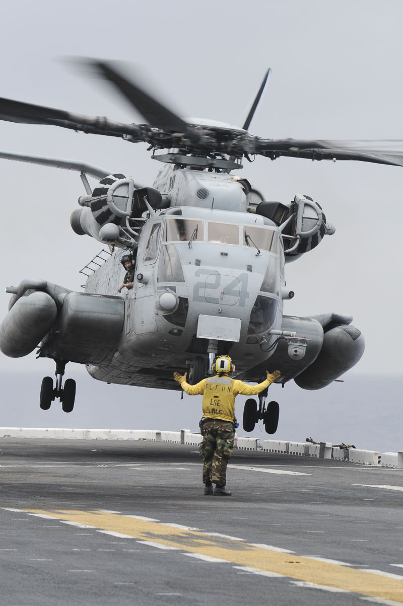 A Sikorsky CH-53 Sea Stallion lands on the deck of the U.S.S. Peleliu (LHA-5) while in transit from San Diego to Pearl Harbor...
