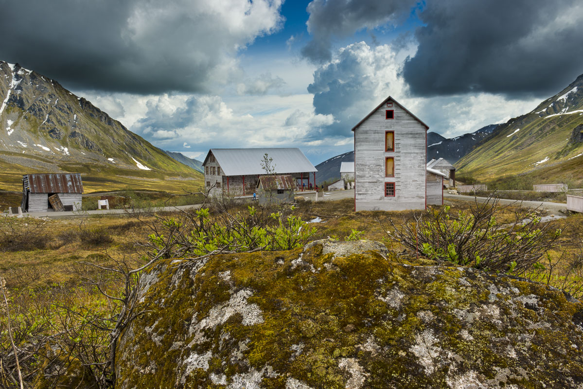 A cluster of historic buildings add a human presence to the alpine landscape in Hatcher Pass State Recreation Area as part of...