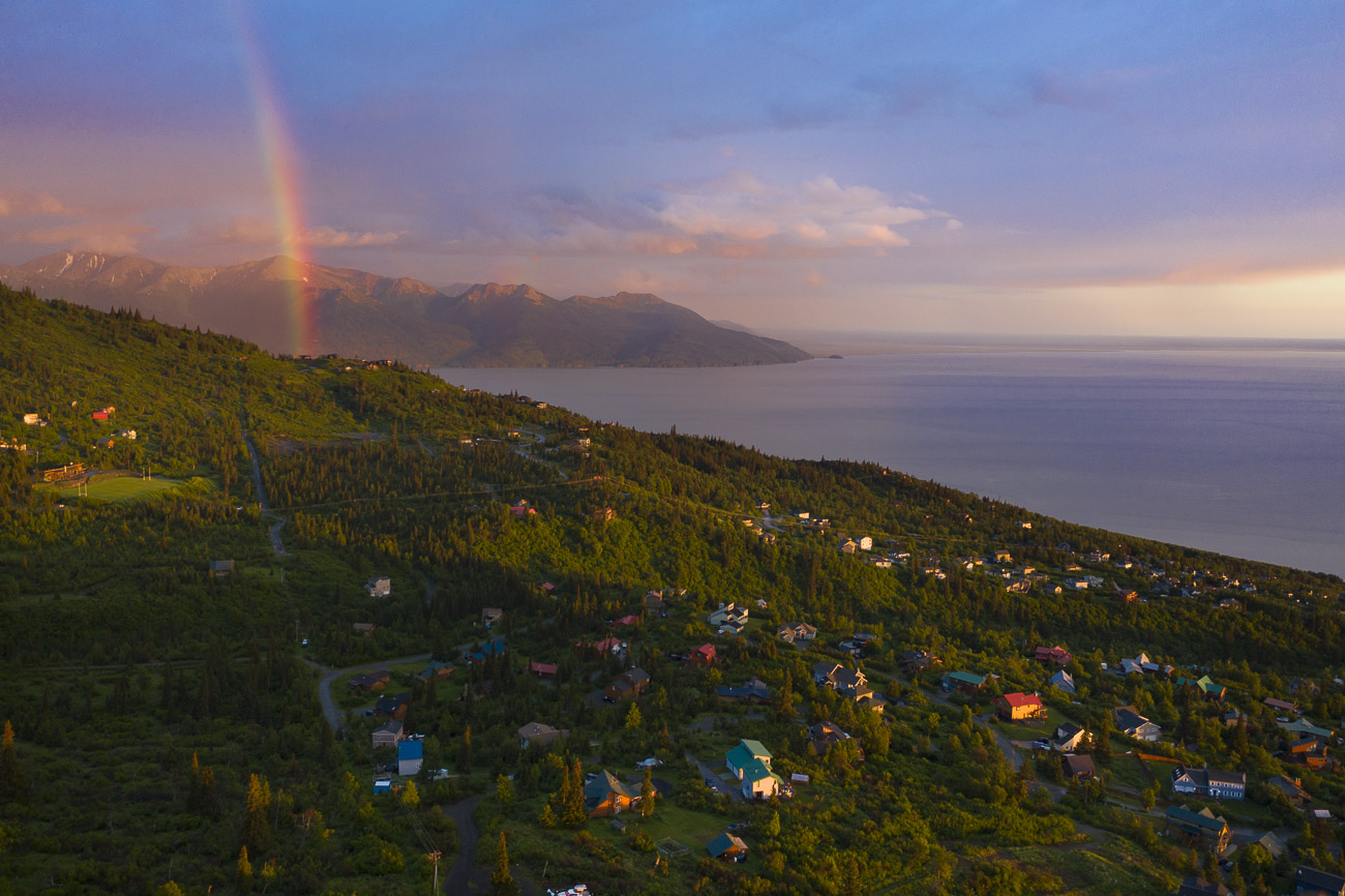 A summer rainbow lights up the sky over part of the Hillside area of Anchorage.