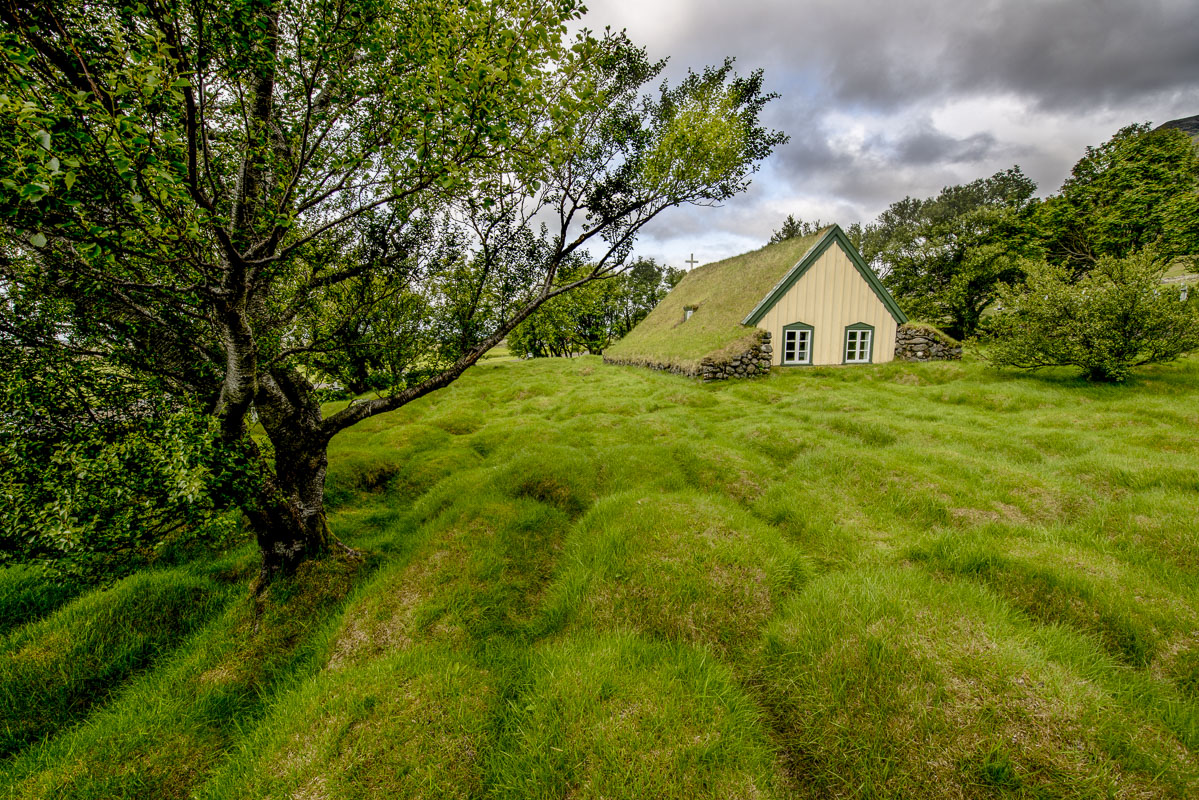 Oringally built in 1884, Hofskirkja is the last turf church built in Iceland. The grassy mounds surrounding it are unmarked graves...