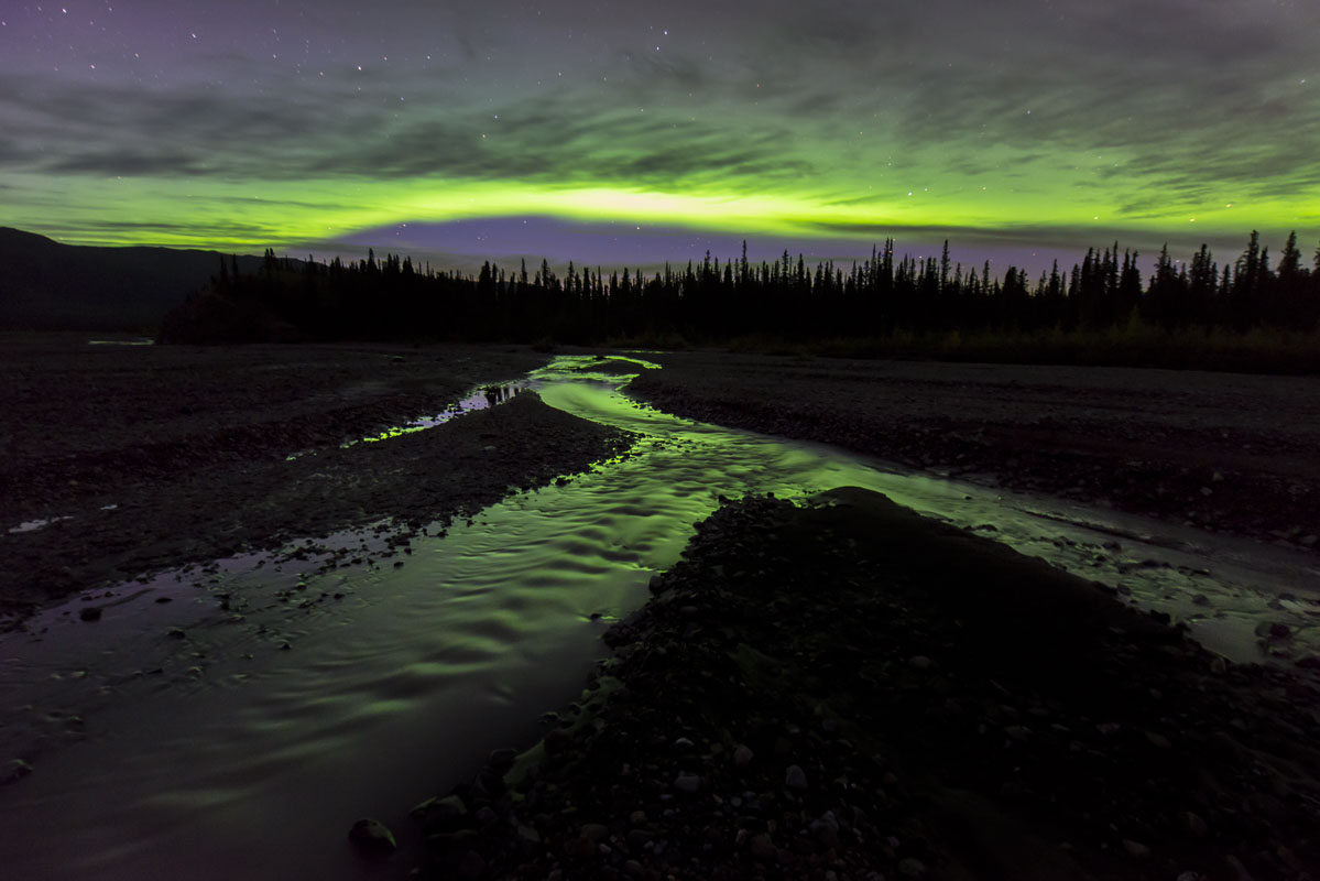 Aurora borealis over the Teklanika River in Denali National Park & Preserve. One of the advantages of camping at the Teklanika...