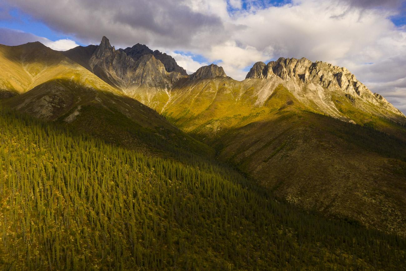 Evening light falls across a striking but unnamed mountain ridge in the Brooks Range in Alaska.