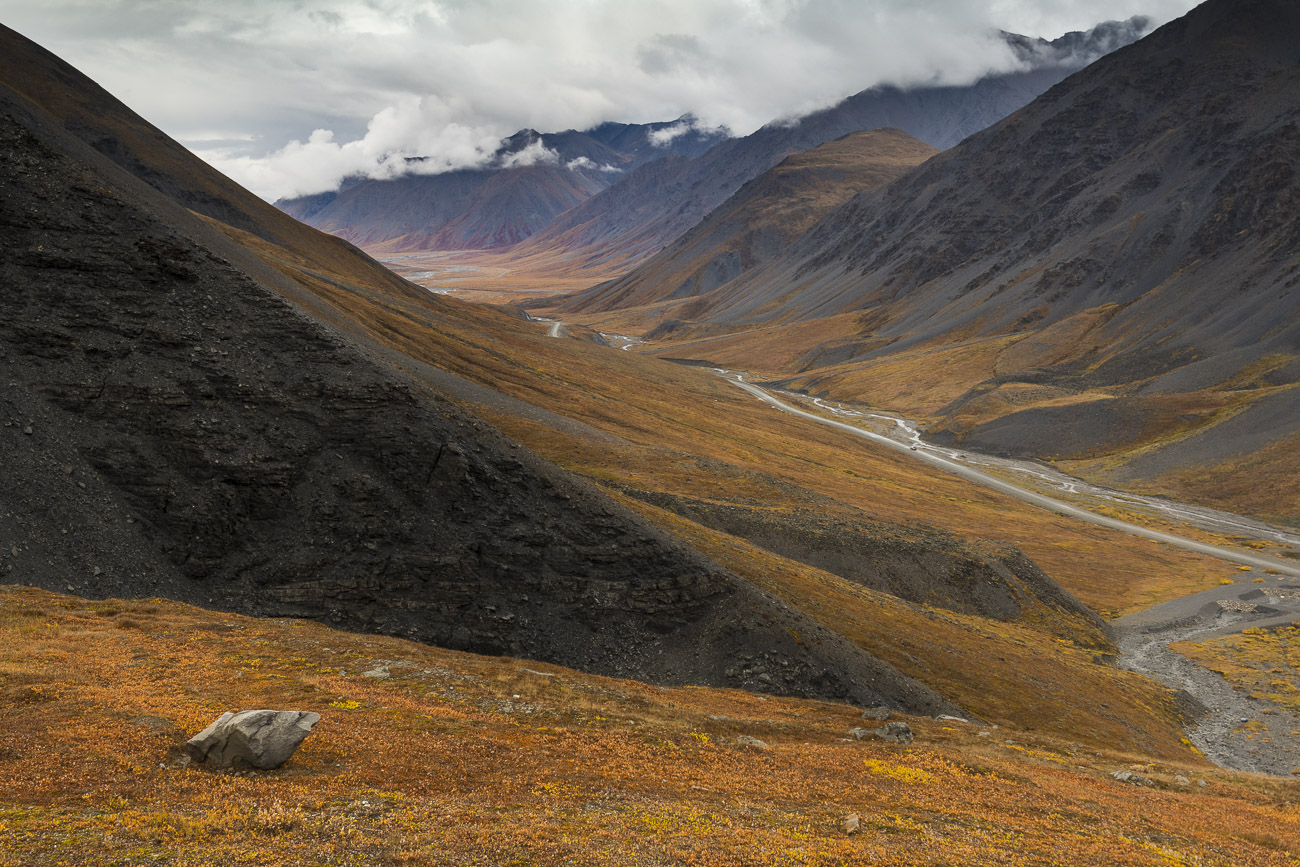 After passing over Atigun Pass, the Dalton Highway stretches out toward the last of the Brooks Range and the open plains of Alaska...