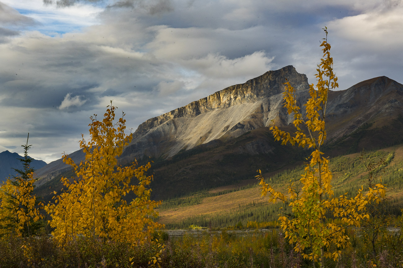 Shafts of light shine through the scattered clouds in the morning to highlight a mountain ridge on the other side of the Dietrich...