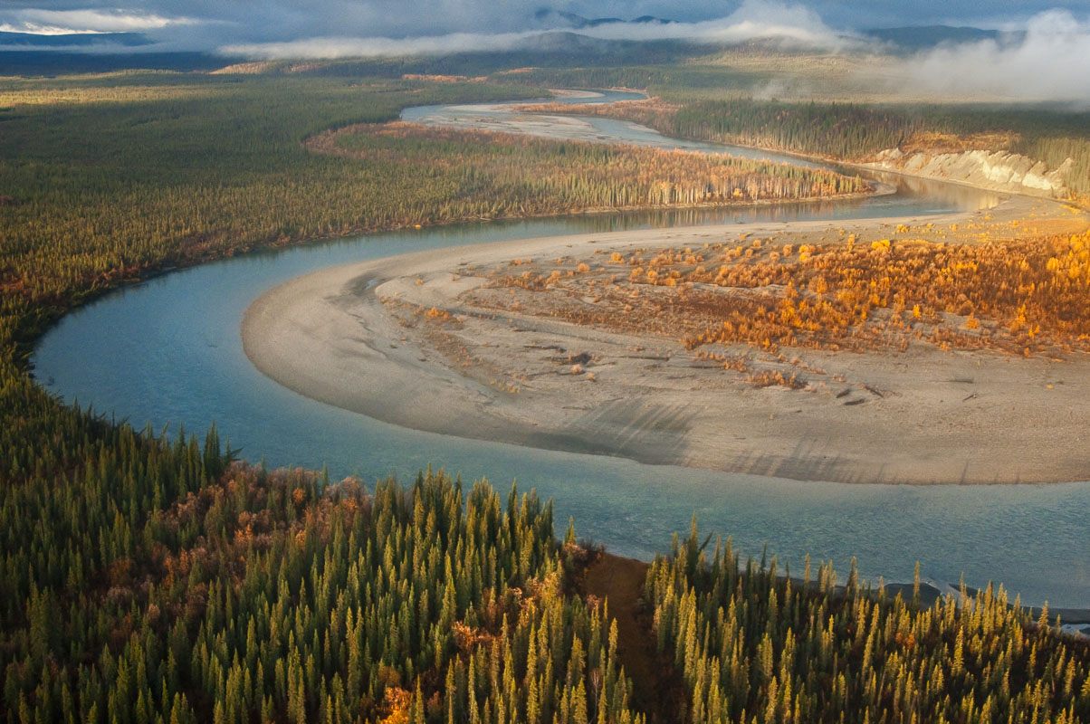 Evening light falls on a bend in the Middle Fork of the Koyukuk River in the Brooks Range of northern Alaska in autumn.