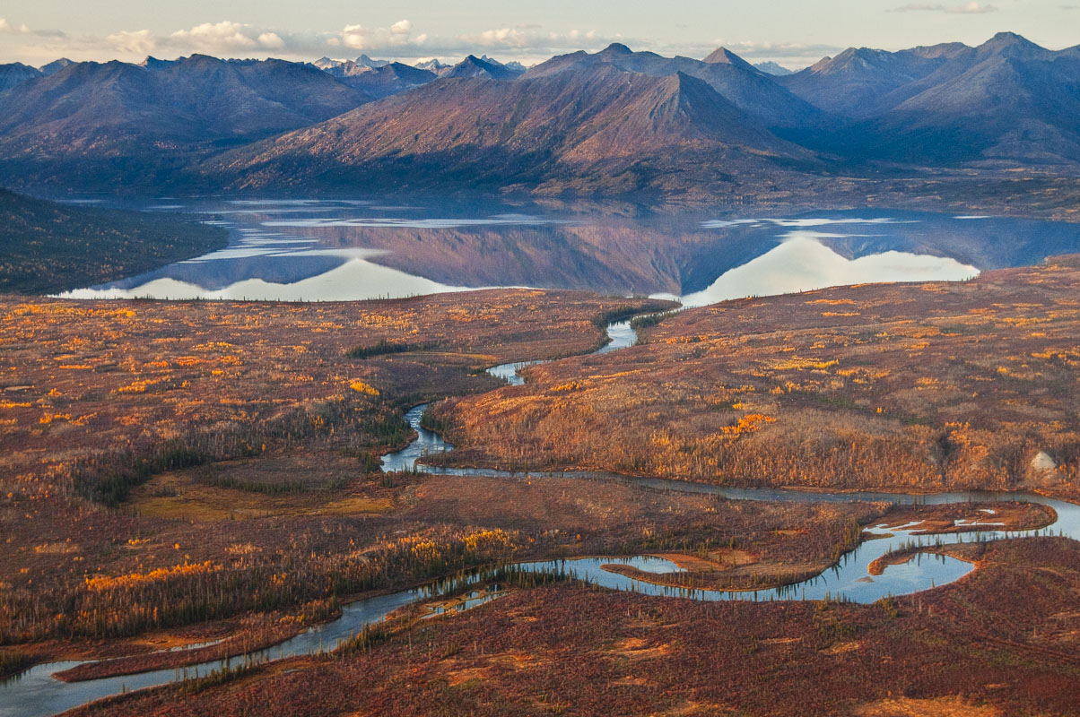 The lower end of Walker Lake, a National Natural Landmark, refelects evening light in the autumn in Gates of the Arctic National...