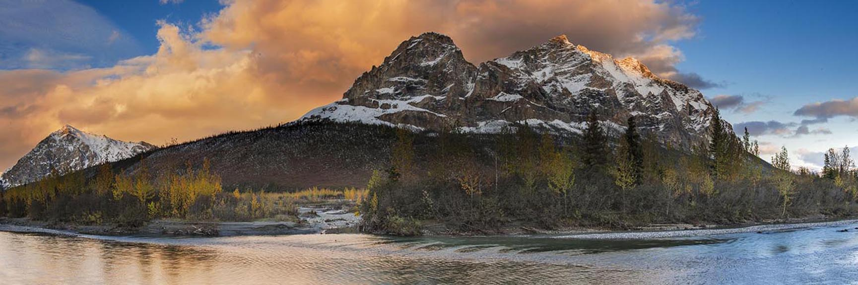 Evening light brushes Mt. Sukakpak along the Middle Fork of the Koyukuk River in the Brooks Range. This panoramic view from the...