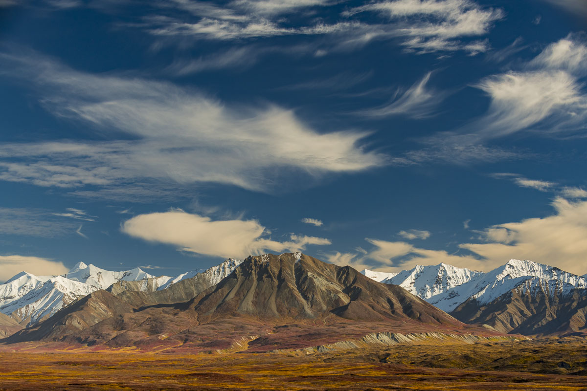 Ever-changing clouds and patterns swirl over the Alaska Range near the McKinley River in Denali National Park & Preserve.