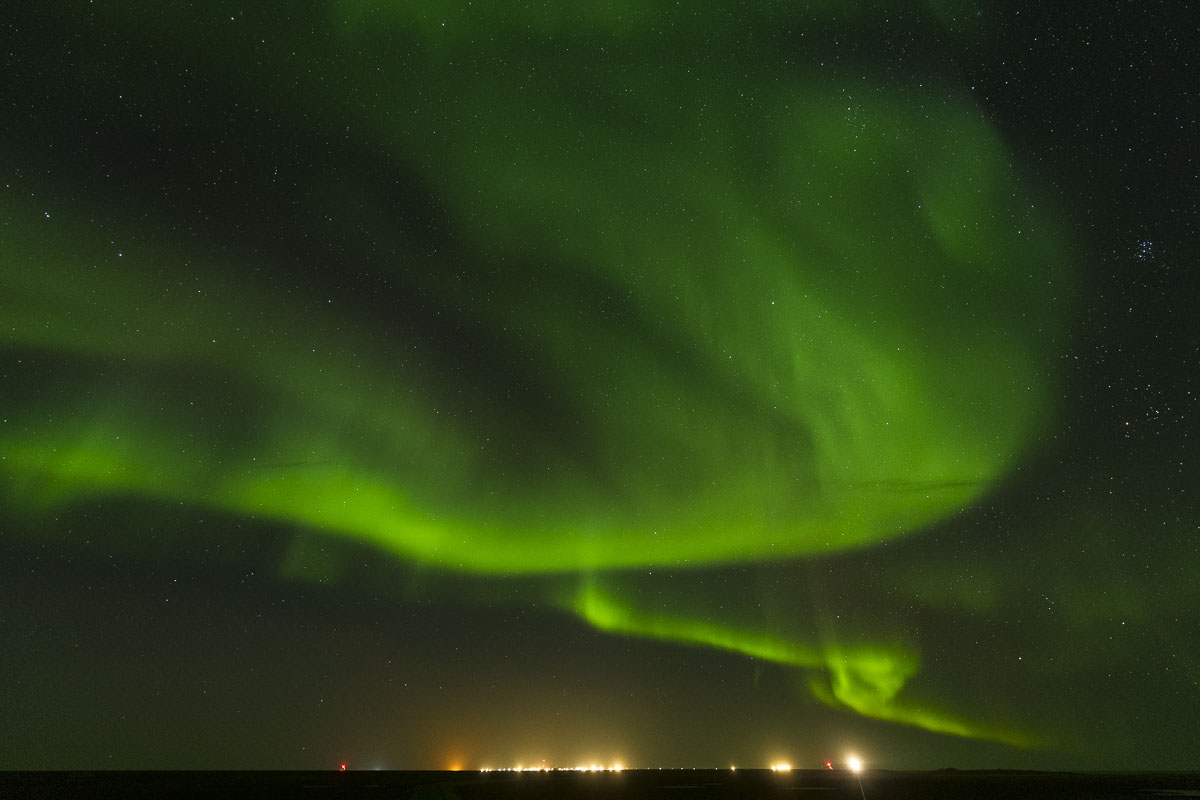 Light from the Inupiat village of Kaktovik cannot compete with the aurora borealis dancing over the Arctic tundraw of Barter...