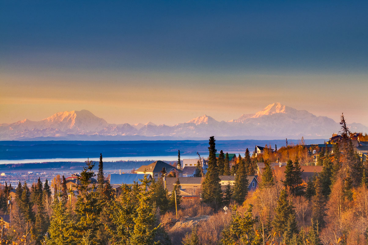 Mt. Foraker, Hunter and McKinley as viewed from an Anchorage hillside neighborhood in the autumn.