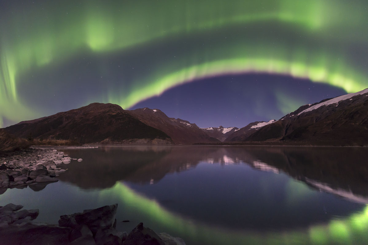 A double arc of aurora borealis fills the sky over Portage Lake, Chugach National Forest, Alaska, in October.