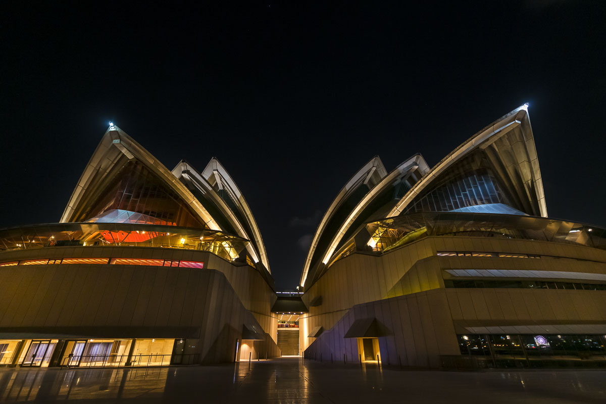 Twin elements of the Sydney Opera House face the downtown waterfront area.