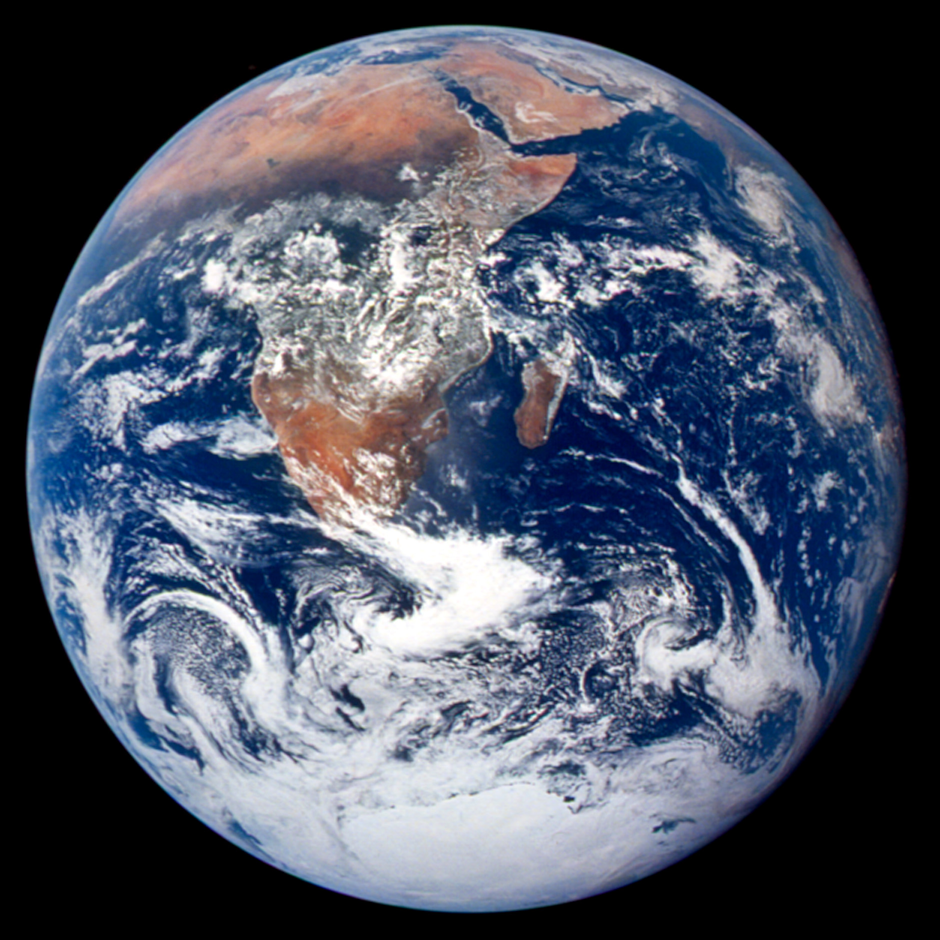 "Astronaut photograph AS17-148-22727, the first ""Blue Marble"" photo,  taken on December 7, 1972 during the Apollo 17 mission...."