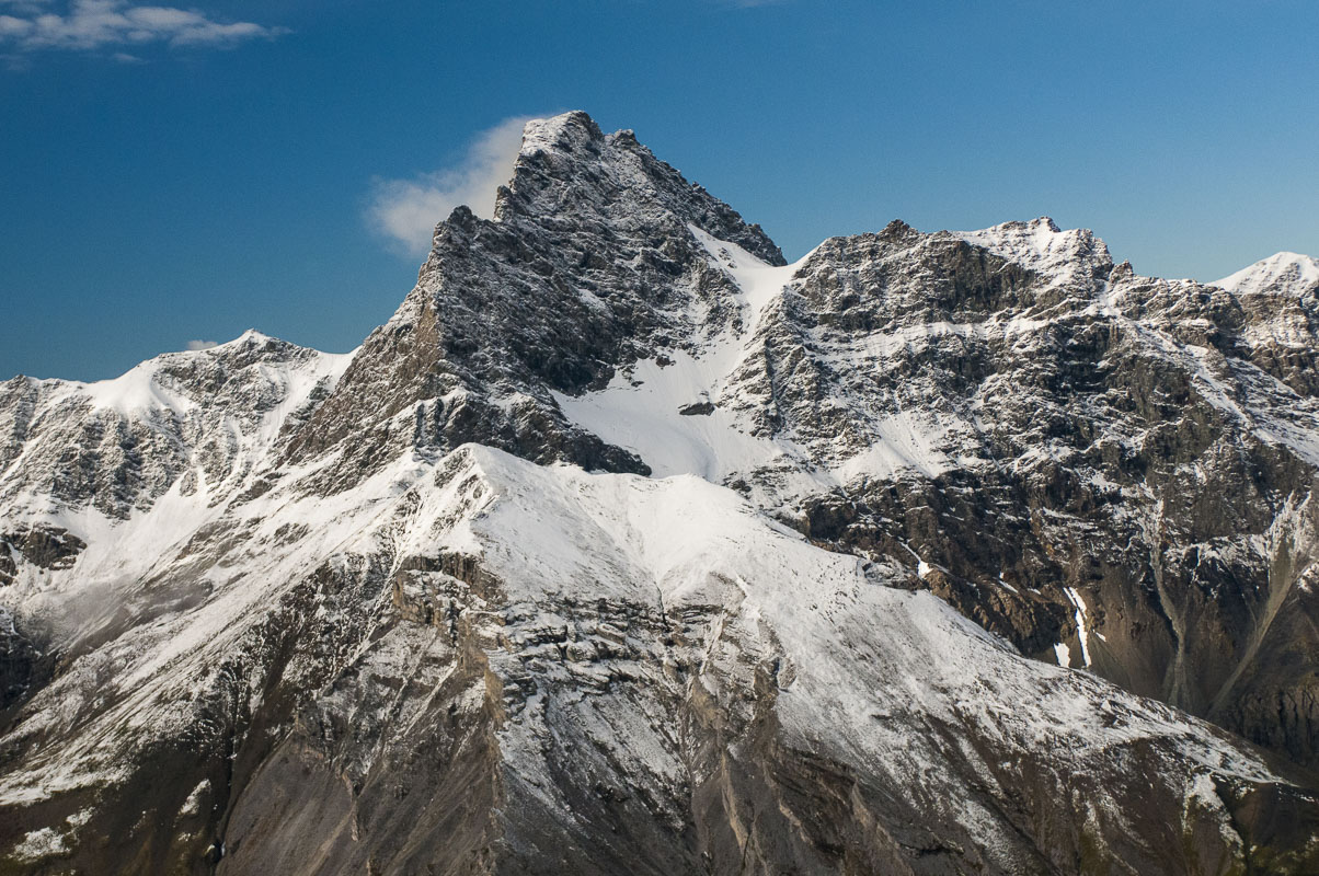 Winds blow loose snow off the face of Mt. Doonerak in the Brooks Range, Gates of the Arctic National Park & Preserve.